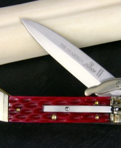 Hubertus Switchblade Springer lever lock Knife The Guardian Jugged Bone Red for sale