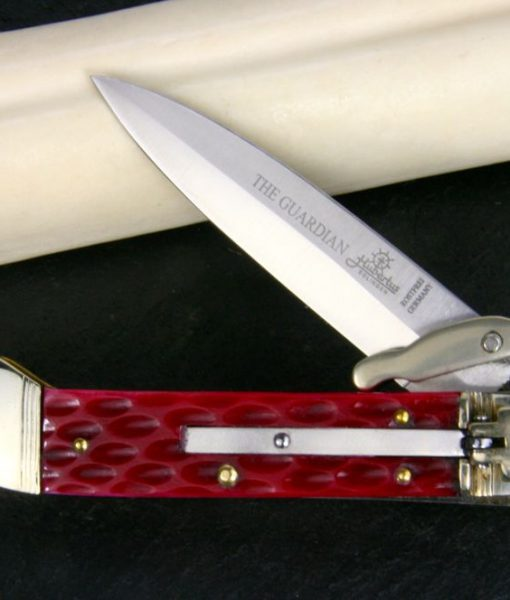 Hubertus Switchblade Springer lever lock Knife The Guardian Jugged Bone Red
